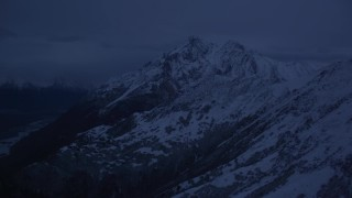 AK0001_0614 - 4K stock footage aerial video flying by snowy Chugach Mountains, pan to river valley, Palmer, Alaska, sunrise