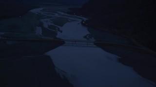 AK0001_0617 - 4K stock footage aerial video flying over Knik River, reveal Old Glenn Highway Bridge, Knik River, Alaska, sunrise