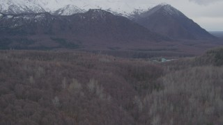 AK0001_0623 - 4K stock footage aerial video flying over wooded hills, approaching Chugach Mountains, Birchwood, Alaska