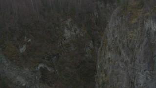 AK0001_0628 - 4K stock footage aerial video fly through deep river gorge, Birchwood, Alaska