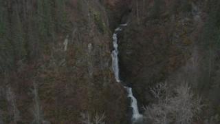 AK0001_0631 - 4K stock footage aerial video approaching waterfall between wooded hills, Birchwood, Alaska
