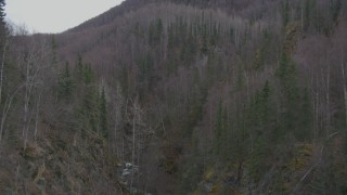 AK0001_0633 - 4K stock footage aerial video flying above a river gorge, approaching wooded hills, Birchwood, Alaska