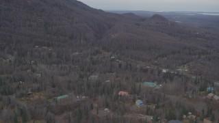 AK0001_0649 - 4K stock footage aerial video flying over homes, wooded foothills, tilt down, Birchwood, Alaska