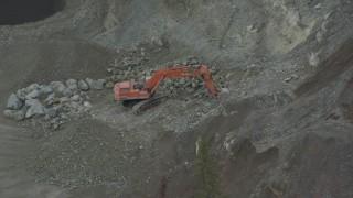 AK0001_0656 - 4K stock footage aerial video orbiting an excavator working on a hillside, Chugiak, Alaska