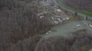AK0001_0658 - 4K stock footage aerial video flying over rock quarry, heavy equipment, wooded areas, Chugiak, Alaska