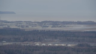 AK0001_0666 - 4K stock footage aerial video tracking military jet approaching Elmendorf Air Force Base, Anchorage, Alaska