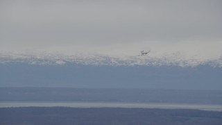 AK0001_0670 - 4K stock footage aerial video E-3 Sentry coming in for landing, snowy mountains, Fort Richardson, Alaska