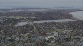 AK0001_0676 - 4K stock footage aerial video flying over residential buildings to Westchester Lagoon, Anchorage, Alaska