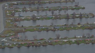AK0001_0684 - 4K stock footage aerial video seaplanes parked in Lake Hood Seaplane Base, Anchorage, Alaska