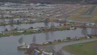 AK0001_0687 - 4K stock footage aerial video flying by Lake Hood Seaplane Base, Lake Hood Strip, Anchorage, Alaska