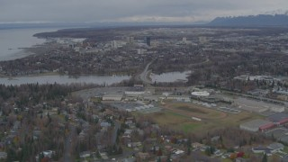 AK0001_0689 - 4K stock footage aerial video flying over Anchorage West High School, approach Downtown Anchorage, Alaska