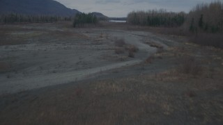 AK0001_0699 - 4K stock footage aerial video flying low over riverbed, trees, during winter, Knik River, Alaska