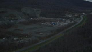 AK0001_0712 - 4K stock footage aerial video flying by hillside rock quarry, Old Glenn Highway, winter, Chugiak, Alaska