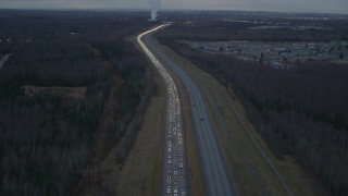 AK0001_0720 - 4K stock footage aerial video flying low over heavy traffic, Glenn Highway, Alaska, twilight