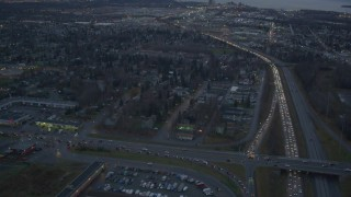 AK0001_0723 - 4K stock footage aerial video following Glenn Highway, revealing Downtown Anchorage, Alaska, twilight