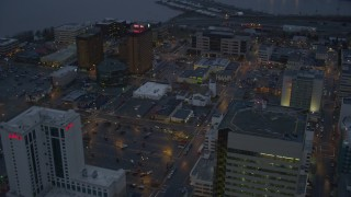 AK0001_0729 - 4K stock footage aerial video flying by Hotel Captain Cook and office buildings in Downtown Anchorage, Alaska, sunset