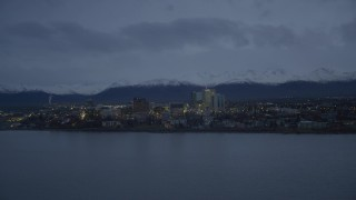 AK0001_0734 - 4K stock footage aerial video fly over Knik Arm of the Cook Inlet, winter, by Downtown Anchorage, Alaska, twilight