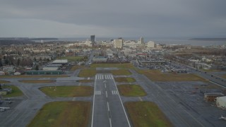 AK0001_0739 - 4K stock footage aerial video ascend from Merrill Field, fly by Downtown Anchorage, Alaska