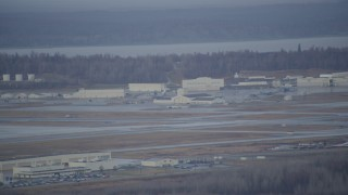 AK0001_0740 - 4K stock footage aerial video flying by hangars, runway in winter, Elmendorf Air Force Base, Anchorage