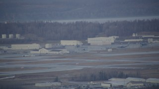 AK0001_0741 - 4K stock footage aerial video a view of hangars, aircraft in winter, Elmendorf Air Force Base, Anchorage
