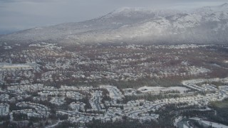 AK0001_0748 - 4K stock footage aerial video Eagle River Valley neighborhoods, Chugach Mountains, winter, Eagle River, Alaska