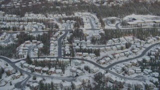 AK0001_0749 - 4K stock footage aerial video snowy residential neighborhood, Eagle River Valley, Eagle River, Alaska