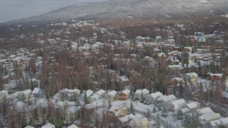 AK0001_0750 - 4K stock footage aerial video snowy residential neighborhood, Eagle River Valley, Eagle River, Alaska