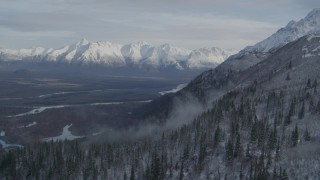 AK0001_0780 - 4K stock footage aerial video approaching Knik River Valley, near snowy Chugach Mountains, Alaska