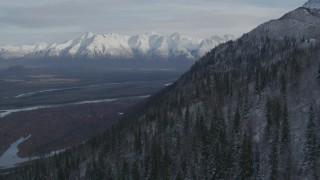AK0001_0781 - Aerial stock footage of Approaching Knik River Valley toward snowy Chugach Mountains, Alaska