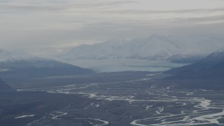 AK0001_0789 - 4K stock footage aerial video Knik Glacier, snowy Chugach Mountains, Swan Lake, Knik River Valley, Alaska