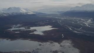 AK0001_0790 - 4K stock footage aerial video tilt from Gull and Swan Lakes, reveal Knik Glacier, snowy Chugach Mountains, Knik River Valley, Alaska