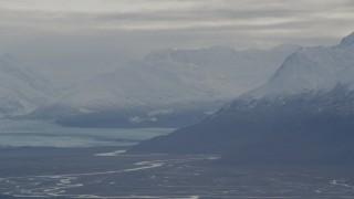 AK0001_0792 - 4K stock footage aerial video flying by Knik Glacier, snow-capped Chugach Mountains, Knik River Valley, Alaska