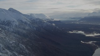 AK0001_0793 - 4K stock footage aerial video Knik Glacier, snowy Chugach Mountains, Swan Lake, Gull Lake, Knik River Valley, Alaska