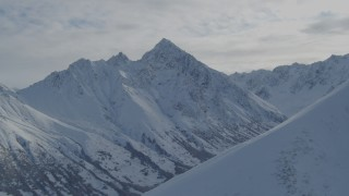 AK0001_0799 - 4K stock footage aerial video approaching valley, snow-covered Chugach Mountains, Alaska