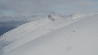 AK0001_0814 - 4K stock footage aerial video over snowy summit in the Chugach Mountains, Alaska