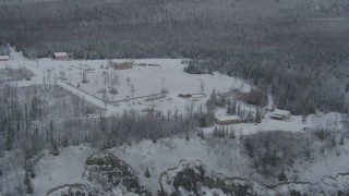 AK0001_0850 - 4K stock footage aerial video flying by snowy King Ranch, forest, Sutton, Alaska