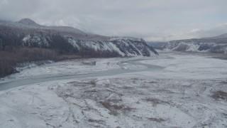 AK0001_0856 - 4K stock footage aerial video flying along icy Matanuska River Valley, Alaska