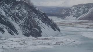 AK0001_0857 - 4K stock footage aerial video descend toward the icy Matanuska River Valley, Alaska