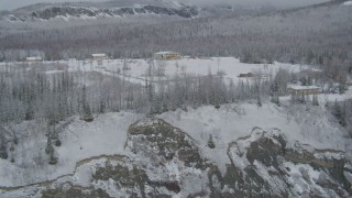 AK0001_0859 - 4K stock footage aerial video ascend up rocky slope, reveal snowy King Ranch, Sutton, Alaska