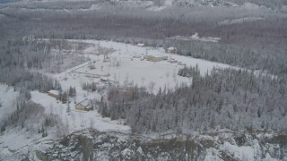 AK0001_0860 - 4K stock footage aerial video flyby King Ranch, reveal snowy Matanuska River Valley, Sutton, Alaska