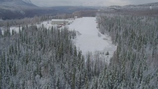 AK0001_0861 - 4K stock footage aerial video descend to snowy runway, King Ranch, Matanuska River Valley, Sutton, Alaska