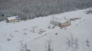 AK0001_0862 - 4K stock footage aerial video ascend and fly away from snowy King Ranch, Sutton, Alaska