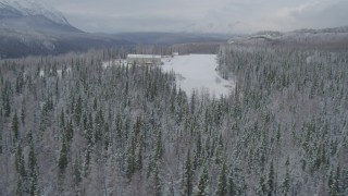 AK0001_0863 - 4K stock footage aerial video descend toward snowy runway, King Ranch, Sutton, Alaska