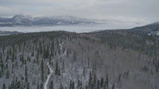 AK0001_0872 - 4K stock footage aerial video approaching snow-covered mountains beyond the Matanuska Glacier, Alaska