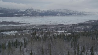 AK0001_0873 - 4K stock footage aerial video approaching Matanuska Glacier near snow covered Chugach Mountains, during winter, Matanuska River Valley, Alaska