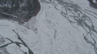 AK0001_0878 - 4K stock footage aerial video bird's eye view of the icy, snow covered river during winter, Matanuska River Valley, Alaska