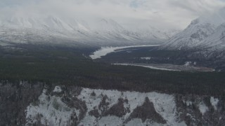 AK0001_0881 - 4K stock footage aerial video flying by Chugach Mountains and snow-covered Matanuska River Valley, Alaska