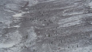 AK0001_0885 - 4K stock footage aerial video tilt up to snow-covered Chugach Mountain slope, Alaskan Wilderness