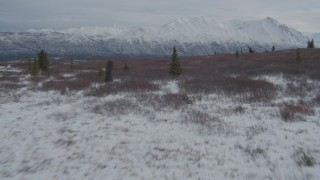 AK0001_0890 - 4K stock footage aerial video flying low over snow-covered frozen Goober Lake, Alaska