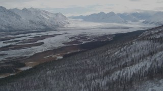 AK0001_0892 - 4K stock footage aerial video approaching glacier at end of the snow covered Tazlina River Valley, Alaska